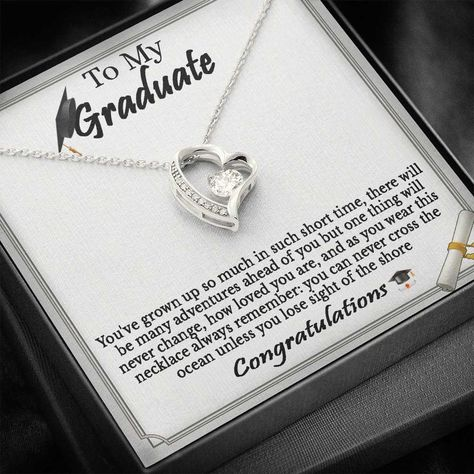 """Give a loving gift that will make her heart melt! This dazzling Forever Love Necklace features a polished heart pendant surrounding a flawless 6.5mm cubic zirconia, embellished with smaller crystals adding extra sparkle and shine. The pendant is crafted in your choice of 14K white gold finish or 18K yellow gold finish, and dangles from an adjustable cable chain secured with a lobster clasp.Product Details:• 14K white gold finish or 18K yellow gold finish• Adjustable cable chain 18"""" - 22""""• 6.5mm"""