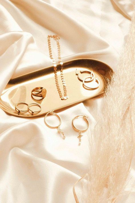 Gold jewels and silk are a dream combo. Jewelry flatlays at its best - gold filled jewelry by S-kin Studio Jewelry. #minimalisticjewelryearrings