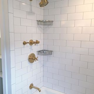 How Do You Feel About Mixed Metals This Client Used The Vibrant Gold Purist Line From Kohler With The Brushed Shower Remodel Shower Remodel Diy Corner Shower