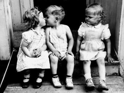 Little Boy And Girl Kissing With Angry Little Girl Watching