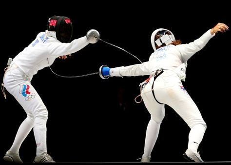 Anna Sivkova of Russia (L) against Courtney Hurley of the U.S in the Women's Epee Team Fencing Finals Day 8
