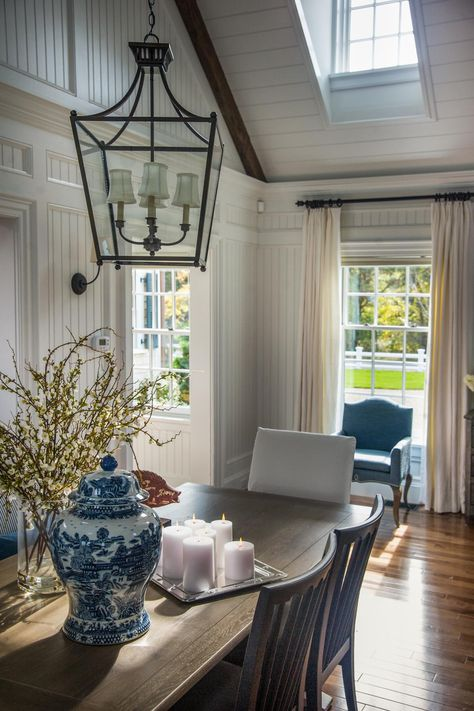 Large windows and perfectly-placed skylights flood the dining room in natural light and provide an excellent view of Martha's Vineyard.