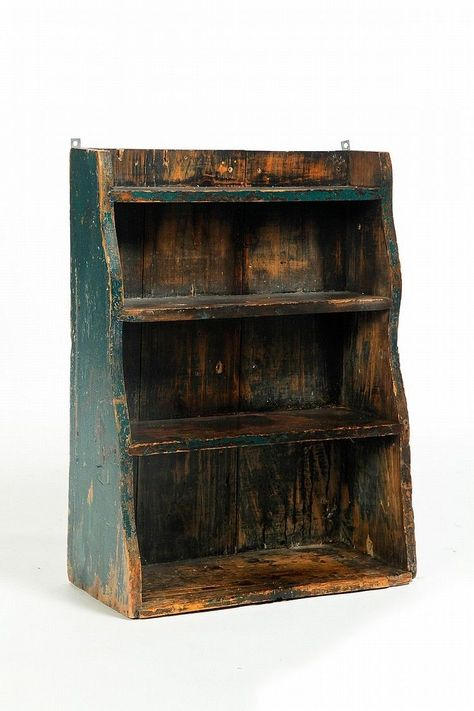 """HANGING SHELF. American, 19th century, pine. Shaped ends and old green paint. 28""""h. 21""""w."""