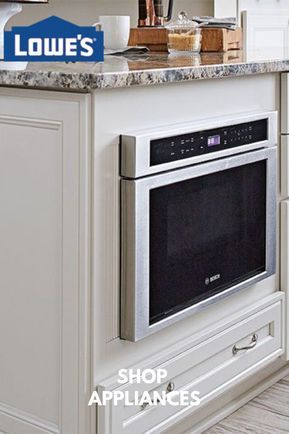 A Drawer Style Microwave Oven Built In The Peninsula Of A Kitchen