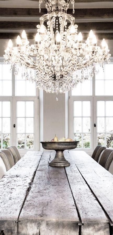 Rustic elegance.  Like this idea for a dining room.  Smaller chandelier, though!