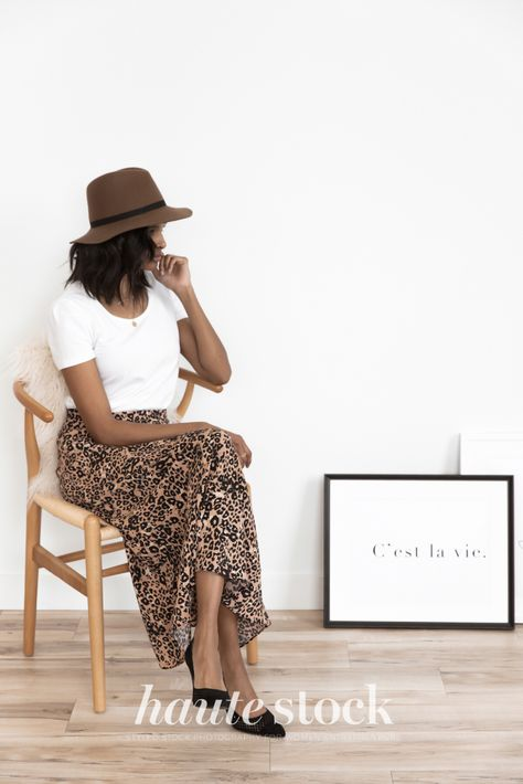 Neutral creative processes styled stock photography for designers featuring fashionable woman sitting in her studio with frame mockup. #hautestock #workspace #stockphotography #styledstockphotography #femaleentrepreneur #blogger #socialmedia #graphicdesign #designer #neutral #interiordesign #creative