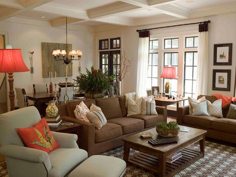 An Inviting Conversation Area Is Created With A Chocolate Brown Couch And  Two White Chairs In This Transitional Living Room. Tall Window Treatmentsu2026 Part 92