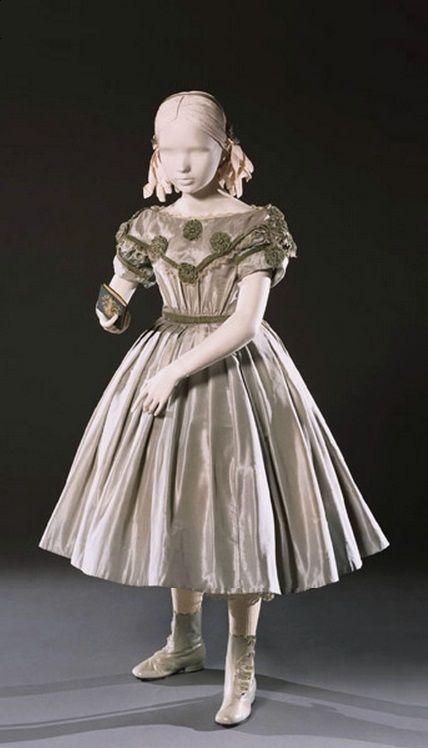 Silk taffeta dress with velvet ribbon, lace, and rhinestones. c.1860's - Courtesy of the Philadelphia Art Museum. civil war era fashion girl