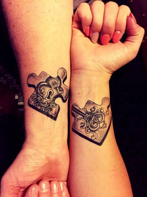 Wonderful looking couple tattoo in puzzle shapes. Just like jigsaw puzzles, there are puzzle pieces that will fit together inked on both hands. Inside the puzzle are a key and a keyhole signifying that both pieces go together when joined.