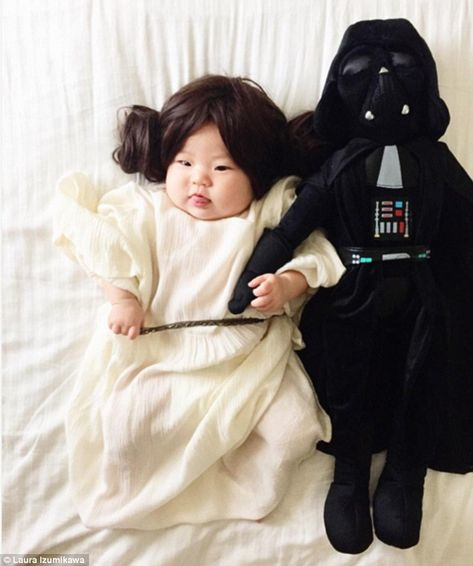 Taking on the force: Whenever the little girl wakes up during the photo shoots, her mom claims she just goes right back to sleep