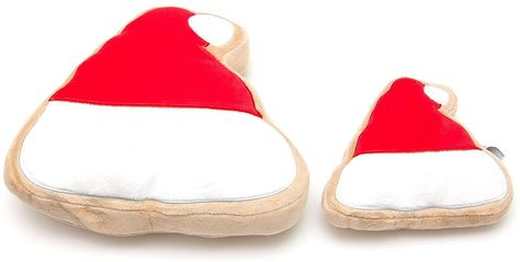 """Designed to resemble your favorite Christmas Sugar Cookies, this Santa Hat Sugar Cookie Plush Dog Toy is a fun, festive, and super cute gift to give your furry best friend. It's a soft plush dog toy shaped and decorated like Santa's stocking hat! While you and your family enjoy human Christmas treats, your pup can have fun playing with this soft squeaky dog toy!- Large measures 9"""" in length x 7.5"""" in width x 2.5"""" in height- Also available in Small size- A perfect stocking stuffer!"""