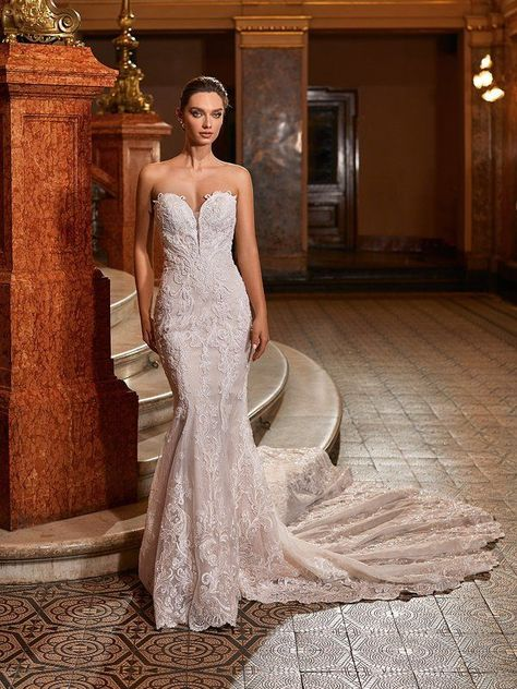 Make way for Val Stefani Style Diva and its glamorous mermaid wedding dress. This strapless bridal style features re-embroidered lace appliques with sequins and glass and seed bead sequins that shine. For a sexy look, the strapless sweetheart neckline leaves you feeling confident as can be. #weddingdress #straplessweddingdress #mermaidweddingdress #laceweddingdress