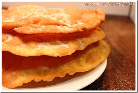 Mexican Buñuelos are light and crispy sprinkled with sugar.  (usually made at Christmas and New Year,  Great recipe with step by step instructions,