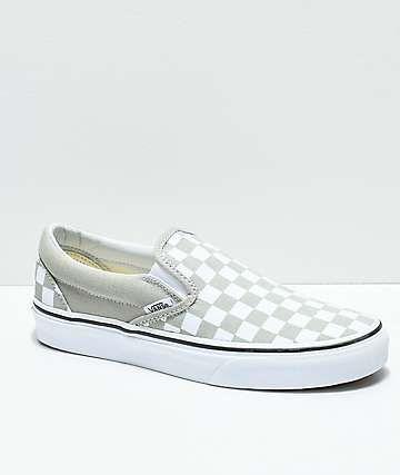 all white checkerboard slip on vans
