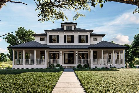 house architecture design The Greensboro plan is loaded with Southern charm! The exterior of the home has a sprawling wrap-around covered porch and blends siding, metal roofing and shutters into a perfect southern mixture.
