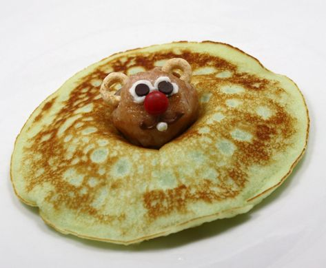 I know the groundhog lied this year, but.Groundhog Day Pancakes ~ Use a donut hole for head, Cherrios for ears, use white icing and mini chocolate chips for eyes, mini red M & M for the nose :)