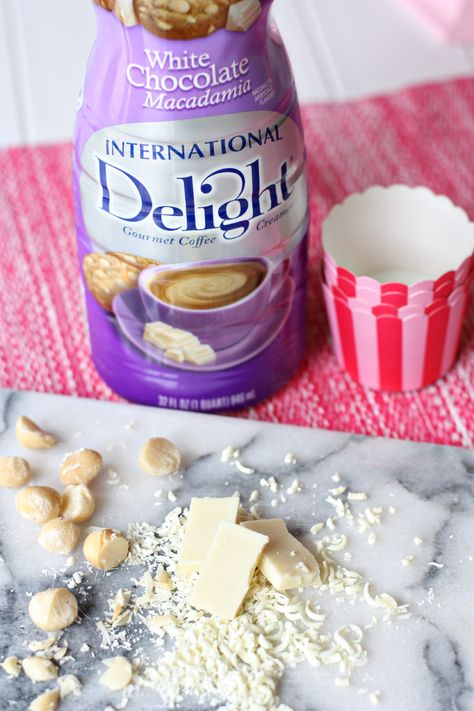 frosting -  8 Tbs (1 stick) unsalted butter, at room temperature  4-5 cups confectioner's sugar  1/3 cup International Delight's White Chocolate Macadamia  white chocolate curls + macadamia nuts for garnish (optional)