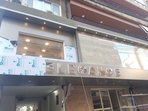 اليكوبوند ستالس ستيل بلاكسي فينيل فلكس ايلي كبوند للتواصل الاتصال بالرقم 0096171170181تعهدات ديكورات شركة تصنيع وتركيب لافتات Storefront Design Design Signage