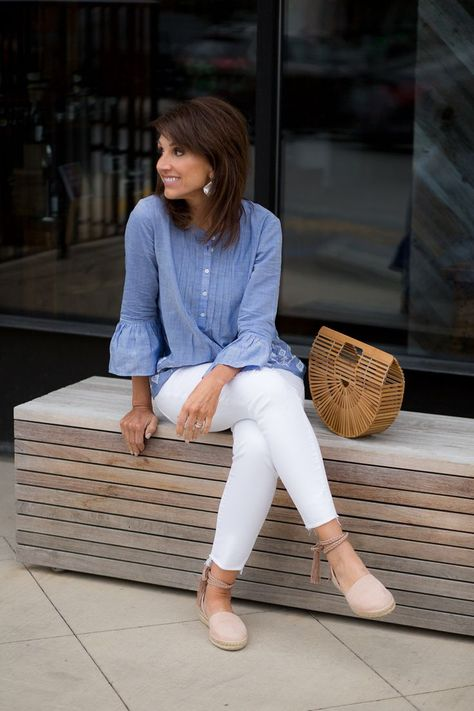 I'm styling a chambray shirt with white jeans for a classic summer look. This outfit is perfect for your summer wardrobe.
