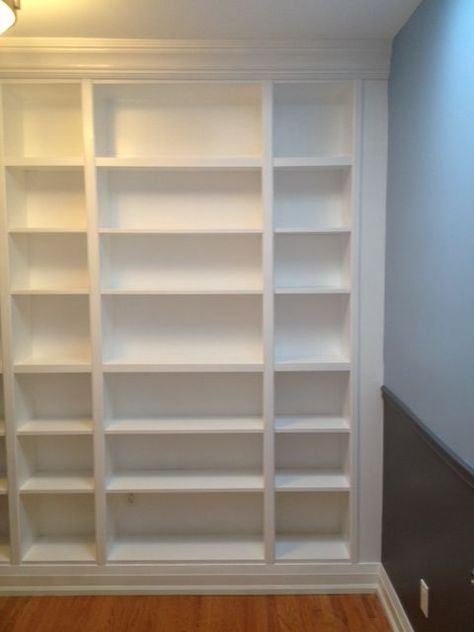 DIY: How To Install IKEA Bookcases So They Look Like Built-In's - lots of pictures and info on how this project was done, including how to allow for electrical outlets and mouldings.