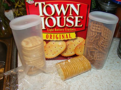 using leftover crystal light containers for storage. this way things like crackers and pretzels won't get as stale or smashed if you throw them in your backpack for school! so smart!