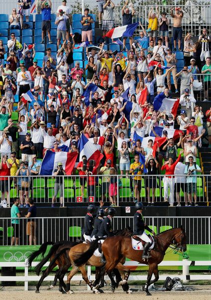 Gold medal medalist's Karim Laghouag, Thibaut Vallette, Mathieu Lemoine and Astier Nicolas of France celebrate after the medal ceremony for the eventing team jumping final on Day 4 of the Rio 2016 Olympic Games at the Olympic Equestrian Centre on August 9, 2016 in Rio de Janeiro, Brazil.