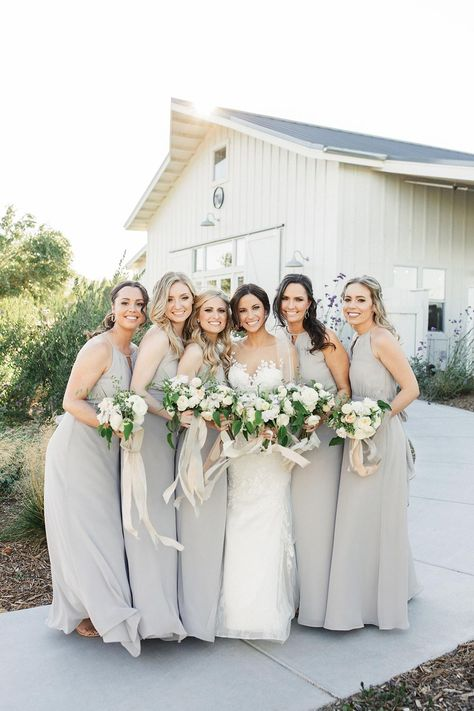 This classic vineyard wedding in Sonoma answers the prayers of every elegant wedding lover. Twisting vines and monochromatic white blooms gleamed in the California sun as Deme and Mike exchanged their heartfelt vows detailing their 11 year relationship. How could we not love a wedding between high school sweethearts? The classic natural palette blends seamlessly with the chic barn interior of the reception space, bedecked with crystal chandeliers for that extra bit of edge! Ready to fall in love