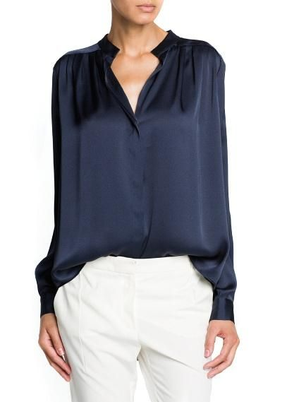 Tuxedo: This satin finish flowy blouse proves than on-trend doesn't mean uncomfortable.