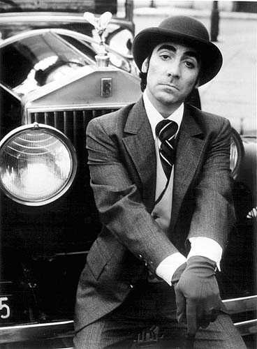 Keith Moon perches himself on the front of his Rolls Royce