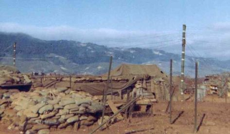 Khe San: The first picture was taken by Earl Clark, Alpha Company 1st Battalion 26th Marines during the siege of Khe Sanh in 1968. He was standing near the ammo dump. The new scars of bomb craters on the hills to the north of the base can be seen.