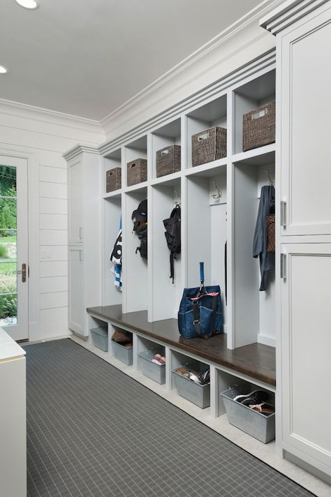 Long Mudroom Features Closed Cabinets Flanking Open Lockers One For Each Family Member Lined With Gray Woven Baskets Over Coat Hook And Galvanized