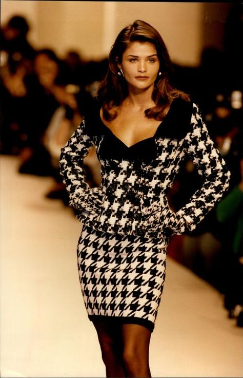supermodels Helena Christensen wears Oscar de la Renta in 1992 on the runway.