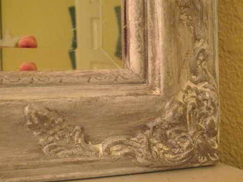 Got a ten dollar gold framed bevelled mirror at Goodwill.  Painted it silver metallic, then white dry brushed.