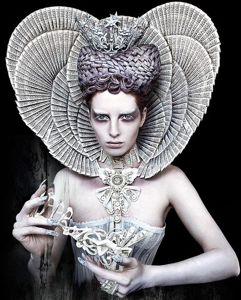 She is an inspiration to me! Her pictures are created without using photoshop. The headdress is made with painted fans. How cool is that!