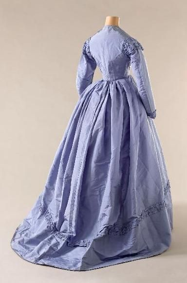 Day Dress: 1865, French, silk taffeta, boned bodice closed front with seven buttons, embellished with ruffles on the shoulders, the wrists and the hem of the skirt.