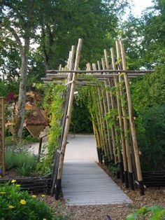 arbor made of tall logs backyard landscaping landscaping garden landscaping
