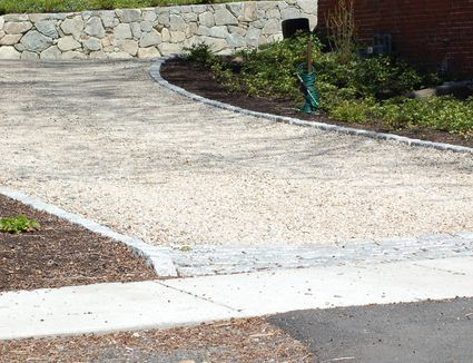 Tar And Chip Driveways Pros And Cons Driveway Materials Poured Concrete Patio Paver Patio Cost