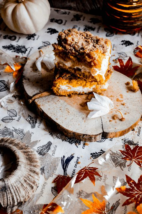 Sandwiched between two layers of moist pumpkin-infused cake sits a luscious cheesecake-like cream cheese filling. To top that off is a crunchy pumpkin spice streusel. This perfect for fall pumpkin cream cheese coffee cake is ideal for breakfast, brunch, or dessert (or all three!!!). #pumpkincreamcheesecoffeecake #pumpkincoffeecake #coffeecake #pumpkincake #pumpkindessert