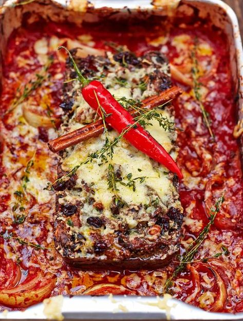 Incredible nut roast with salsa rossa picante    This is an epic nut roast, packed with nuts, fruit, spices and loads of veg, served with a spicy tomato sauce