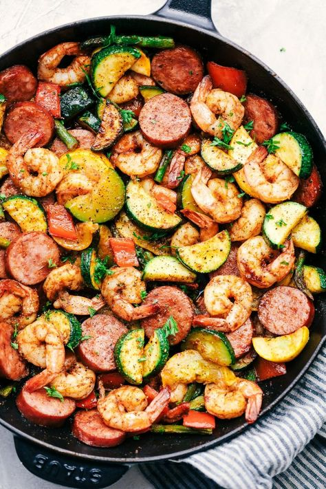Cajun Shrimp and Sausage Vegetable Skillet is the BEST 20 minute meal packed with awesome cajun flavor with shrimp, sausage, and summer veggies. low carb recipes Cajun Shrimp and Sausage Vegetable Skillet Seafood Recipes, Chicken Recipes, Keto Chicken, Sausage And Shrimp Recipes, Cajun Sausage, Shrimp Dinner Recipes, Healthy Shrimp Recipes, Salmon Recipes, Meals With Shrimp