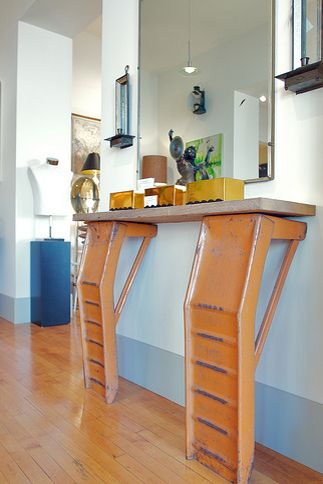 Yes, you can turn old auto parts into surprisingly chic furniture. Housed in Alan Robandt's antique shop, you'd never know this entryway table was made from old car ramps at first glance.