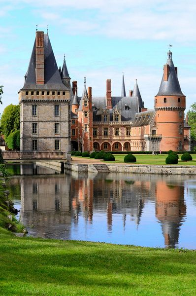 Château de Maintenon, République Française (Maintenon Castle, France)  Clearly visible behind the railings, is the silhouette of the Château de Maintenon. The building would probably have remained anonymous had it not been for its famous owner, who was to leave her mark on the site forever – Madame de Maintenon, and with her, the Sun King himself, Louis XIV.
