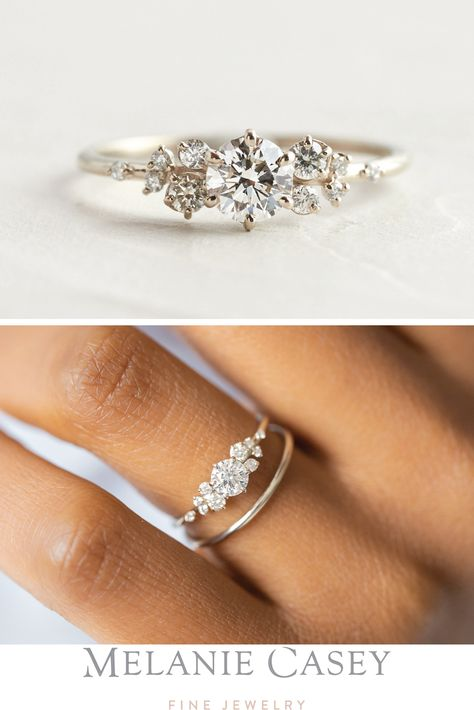 A dainty engagement ring featuring a 0.3ct. round brilliant diamond accented by clusters of white diamond. Set in 14k white gold, the unique Snowdrift collection is available at melaniecasey.com!