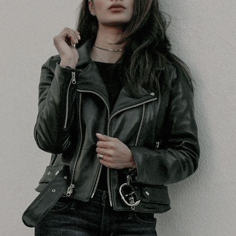 a girl in a leather jacket, grey, brown,