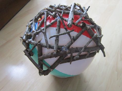Create a twig ball using a beach ball for a template and hot gluing twigs around it. These would be nice in the garden