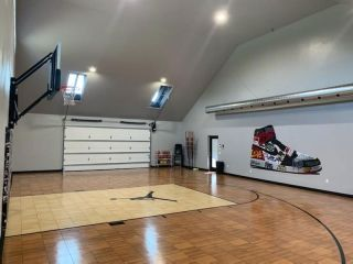 Indoor Bounceback Dark Maple And Light Maple Basketball Court In Garage Backyard Court Home Basketball Court Basketball Court Backyard