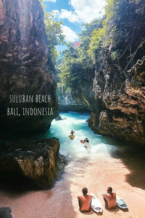 Suluban beach in Bali, Indonesia. Suluban Beach is one of Bali's most unique coasts, concealed by natural limestone formations and accessed via steps and log ramps through narrow gaps in the rock. Canopied by a looming cliff face, this small beach may not be ideal for sunbathers, but serves pro surfers well as a base to paddle out and ride adjacent reef breaks, including around Uluwatu, just to the south.