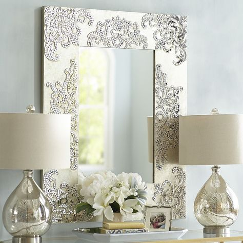To the French, she's strength. To the Celts, she's fire and poetry. To us, Brigette is all glamour and confidence—reflected from the simple silhouette of our striking mirror. The wooden frame is painted by hand in an iridescent champagne hue and covered with scrolled mosaic details. A Pier 1 exclusive.