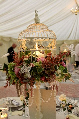 I have several of these (well, similar) pedestal standing birdcages as they were packed with fragrant herbs and flowers as table centres at our wedding. One is in my bedroom as a jewellery and earing stand but I'd love to fill another with artificial flowers to stand on a table in the dressing room.