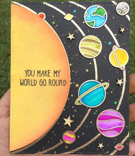One more galaxy/space themed card! This time a You Make my World Go Round/thinking of you card. I used the gold Finetec watercolor palate…